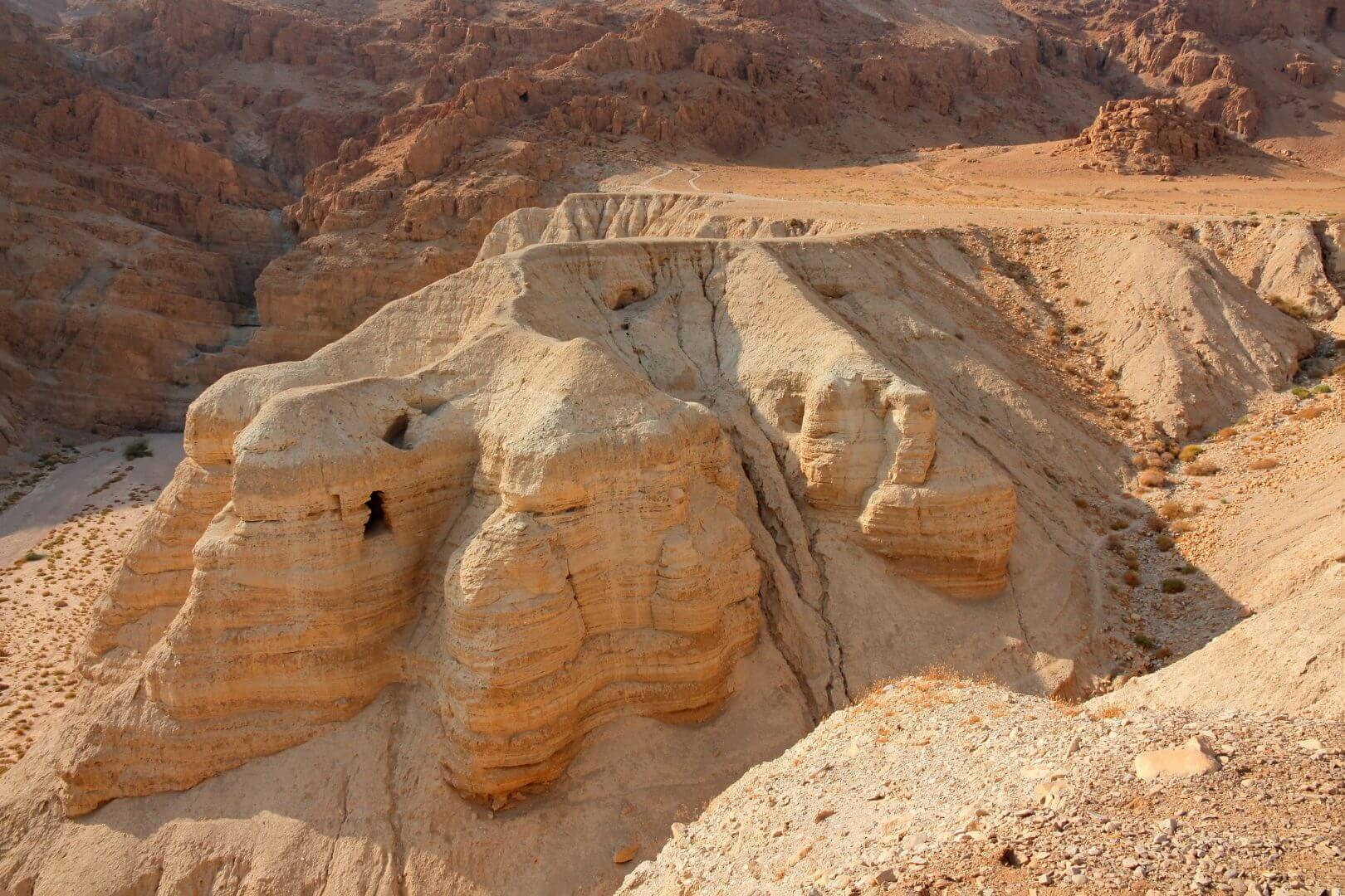Qumran caves at the archaeological site in the Judean desert of the West Bank, Israel.